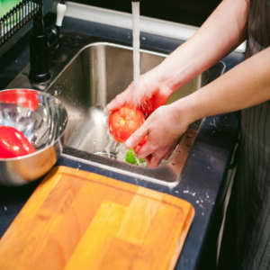 chef washing vegetables