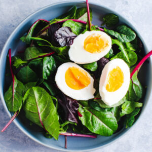 greens topped with hard boiled egg