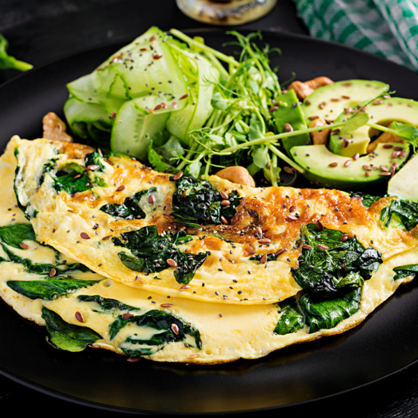 vegetable omelet with avocado slices