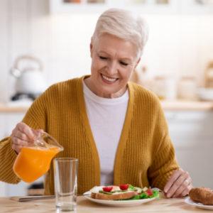 happy senior woman eating